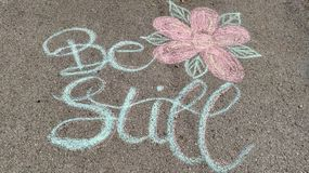 Be Still Driveway Chalk Art Calligraphy Flower royalty free stock photography