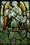 Be Strong. An angel holding the banner reading Be Strong. Fragment of a memorial stained glass window created in 1911 to commemorate a soldier killed during Royalty Free Stock Image