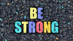 Be Strong on Dark Brick Wall. Royalty Free Stock Photography