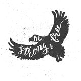 Be strong and free lettering in eagle. Royalty Free Stock Image