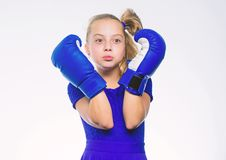 Be strong. Girl child with blue gloves posing on white background. Sport upbringing. Upbringing for leadership and royalty free stock images