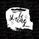 Be strong.Handdrawn brush lettering. Unique lettering made by hand. Great for posters, mugs, apparel design, print Stock Photo