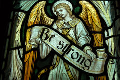 Be Strong, horizontal. An angel holding the banner reading Be Strong. Fragment of a memorial stained glass window created in 1911 to commemorate a soldier killed Stock Photo