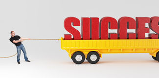 Be strong to success. Caucasian man pull huge success text on truck Stock Image