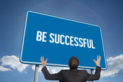 Be successful against cloudy sky with sunshine. The word be successful and gesturing businessman against cloudy sky with sunshine Royalty Free Stock Photo
