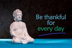 Be Thankful for every day - inspirational and motivating text near little buddha figurine.  Royalty Free Stock Photo