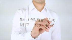 Be Thankful For What You Have, Man Writing on Glass, Handwritten stock photo