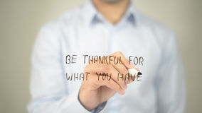 Be Thankful For What You Have , man writing on transparent screen stock photos