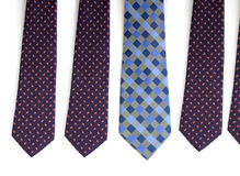 Be unique. One unique tie among several others Stock Photography