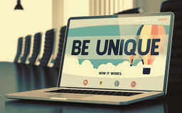 Be Unique on Laptop in Meeting Room. 3D Render. Be Unique on Landing Page of Mobile Computer Screen. Closeup View. Modern Meeting Hall Background. Blurred Image Royalty Free Stock Image