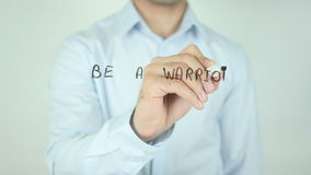 Be a Warrior Not Worrier, Writing On Transparent Screen. Man writing stock video