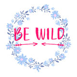 Be wild text in hand drawn wreath frame. Rough phrase for boho and hippie clothes, t-shirts, posters. Inspirational Stock Image
