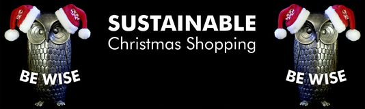 Be Wise, owls with santa hats and text sustainable christmas shopping, black background royalty free stock images