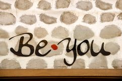 Be you message sign. On old stone wall royalty free stock photography