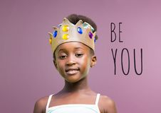 Be you text with Girl wearing crown with blank purple background royalty free stock photography