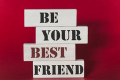 Be your best friend quote. Be your best friend. Motivational quote written on wooden tiles royalty free stock photography