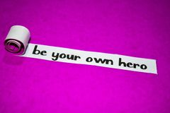 Be your own hero text, Inspiration, Motivation and business concept on purple torn paper royalty free stock photos
