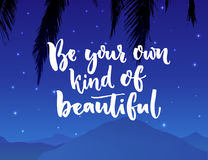 Be your own kind of beautiful. Inspiration quote about beauty and self esteem. Brush typography on night landscape with Stock Images