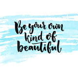 Be your own kind of beautiful. Inspirational quote about beauty and self esteem. Brush lettering at blue watercolor Royalty Free Stock Photo