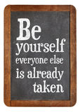 Be yourself reminder blackboard sign. Be yourself, every one else is already taken - reminder on a vintage slate blackboard stock photos