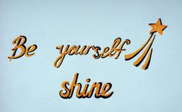 Be yourself shine. Picture inscription `Be yourself shine` and a star. Be your star. Yellow and black inscription on a blue background Royalty Free Stock Photo