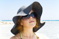 On the beach. Beautiful girl in sunglasses on the beach Stock Images