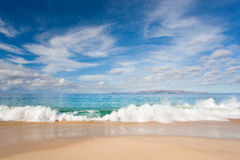 Beach. Makena beach in beautiful tropical maui hawaii with wave and blue sky Royalty Free Stock Images