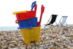 On the Beach. A Child's buckets and spades on the pebble beach at Bognor Regis Sussex royalty free stock photography