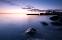 Beach. Early morning whit rocks Royalty Free Stock Images