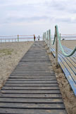 Beach. Boardwalk to the seaside resort at the sunset Royalty Free Stock Image