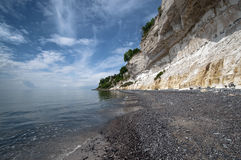 Beach. A coastline consisting of lime with a church on the edge Stock Photo