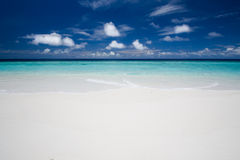 Beach. Tropical white sandy beach and blue sky with white clouds Royalty Free Stock Photo