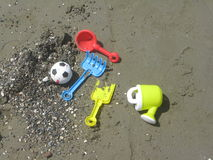 On the beach. Colorful toys on the beach stock images