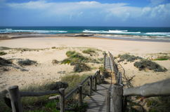 On the beach. Lonely beach on the algarve-coast royalty free stock photos
