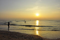 Beach. Sunrise and fisherman at Cha-am Beach ,Thailand royalty free stock photo