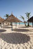 Beach. Empty sandy Beach with sunshades and a lovely blue sea royalty free stock photos