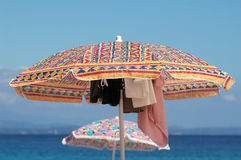 Beach. A beach scene with colourful umbrellas under blue sky Stock Images