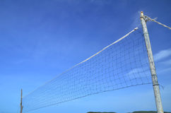 The beach. Beach volleyball net on a blue sky Stock Images