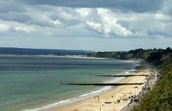 Beach. Coastline of Bournemouth, south of England moody sky royalty free stock images