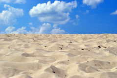 Beach. Sea yellow clean sand on background blue sky Royalty Free Stock Image