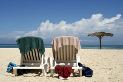 At the beach. Two beach seats at a beach in Cuba royalty free stock images