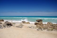 Beach. With rocks and blue sky Stock Photography