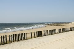 Beach. Landscape from beach with sea, sand and poles Stock Photos