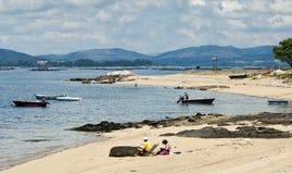 Beach. Vilanova de Arousa, Spain - June 19, 2012: People on the beach on a sunny day Royalty Free Stock Photo
