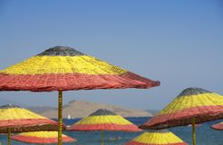 Beach. Umbrellas on Camel Beach. Bodrum Turkey Royalty Free Stock Images
