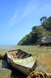 Beach. A lonely boat on a beautiful beach royalty free stock image
