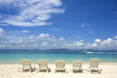 Beach. Photo of blue beach with chairs royalty free stock photos