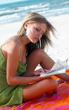 Beach. Girl on the beach with book Stock Image