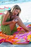 Beach. Girl on the beach with phone Stock Photos
