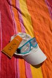 Beach. Objects of bath posed on a beach towel Stock Image